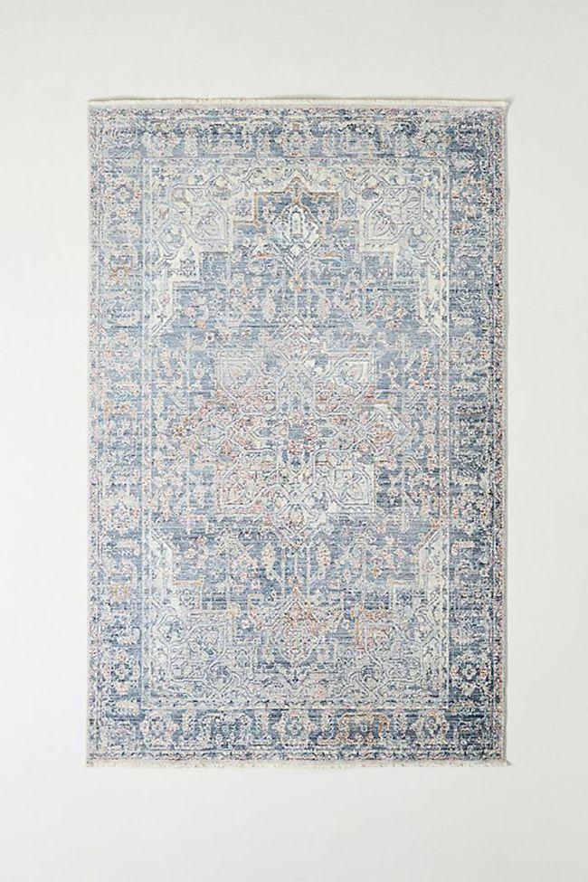 Light blue distressed rug.