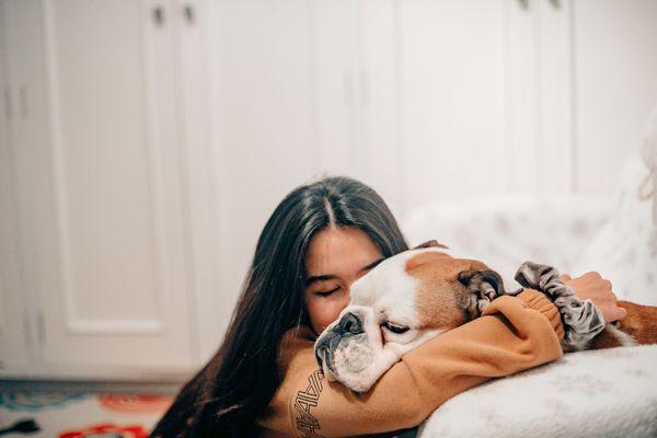 woman and a bulldog