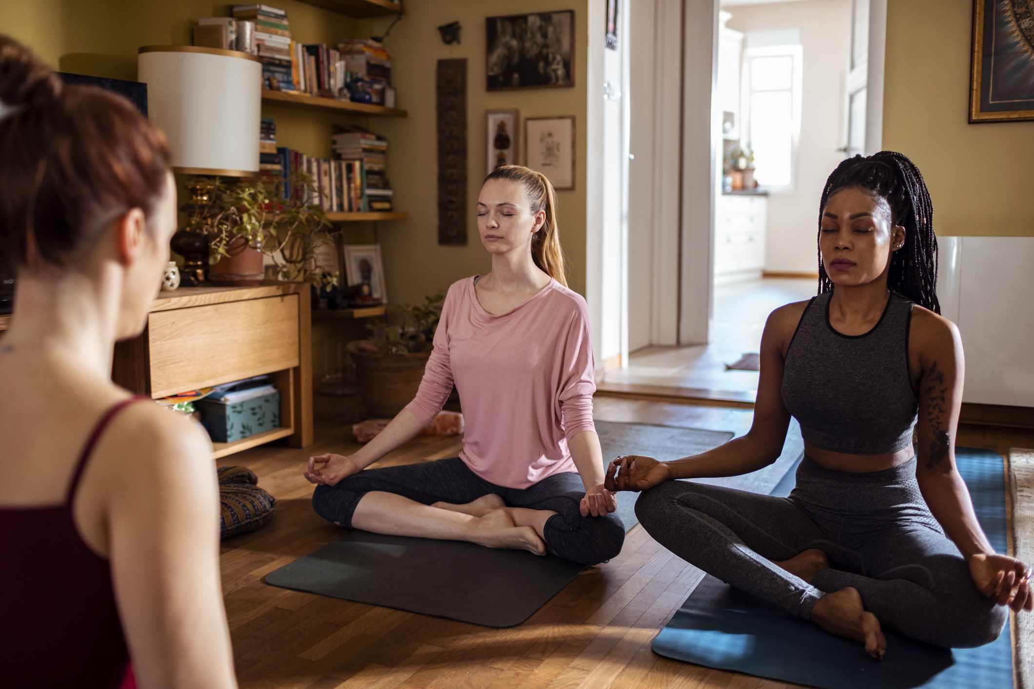 Trio of friends meditating