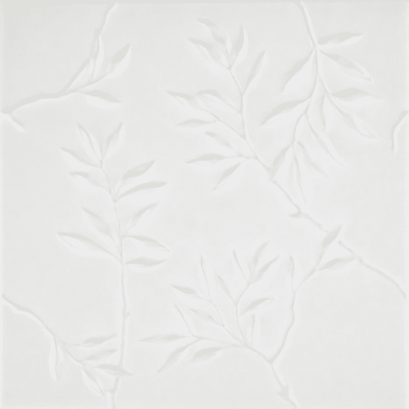 A white tile with leaves carved into it