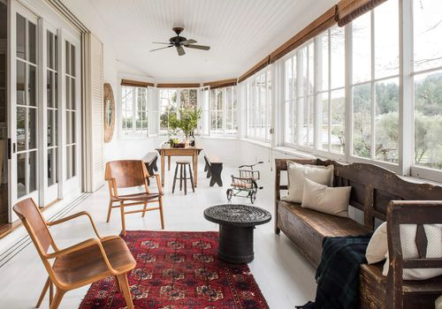 Sunroom with antique wooden bench.