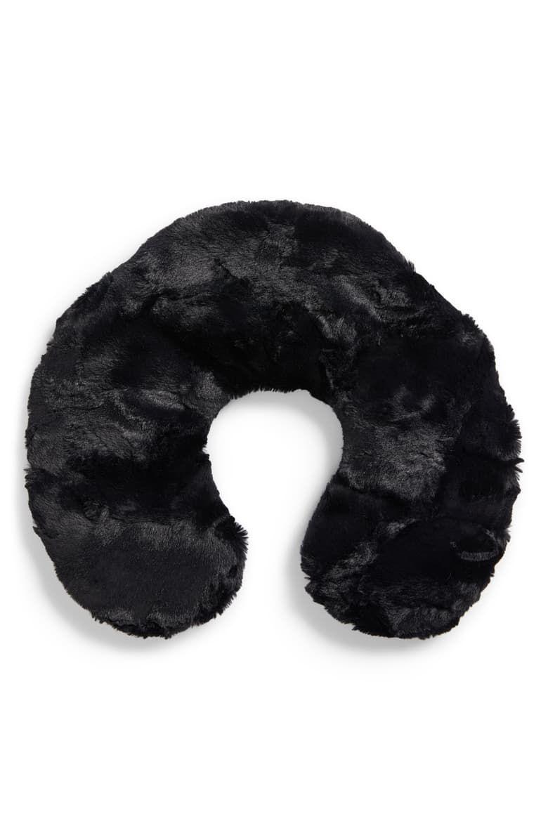 A fuzzy black travel neck pillow.