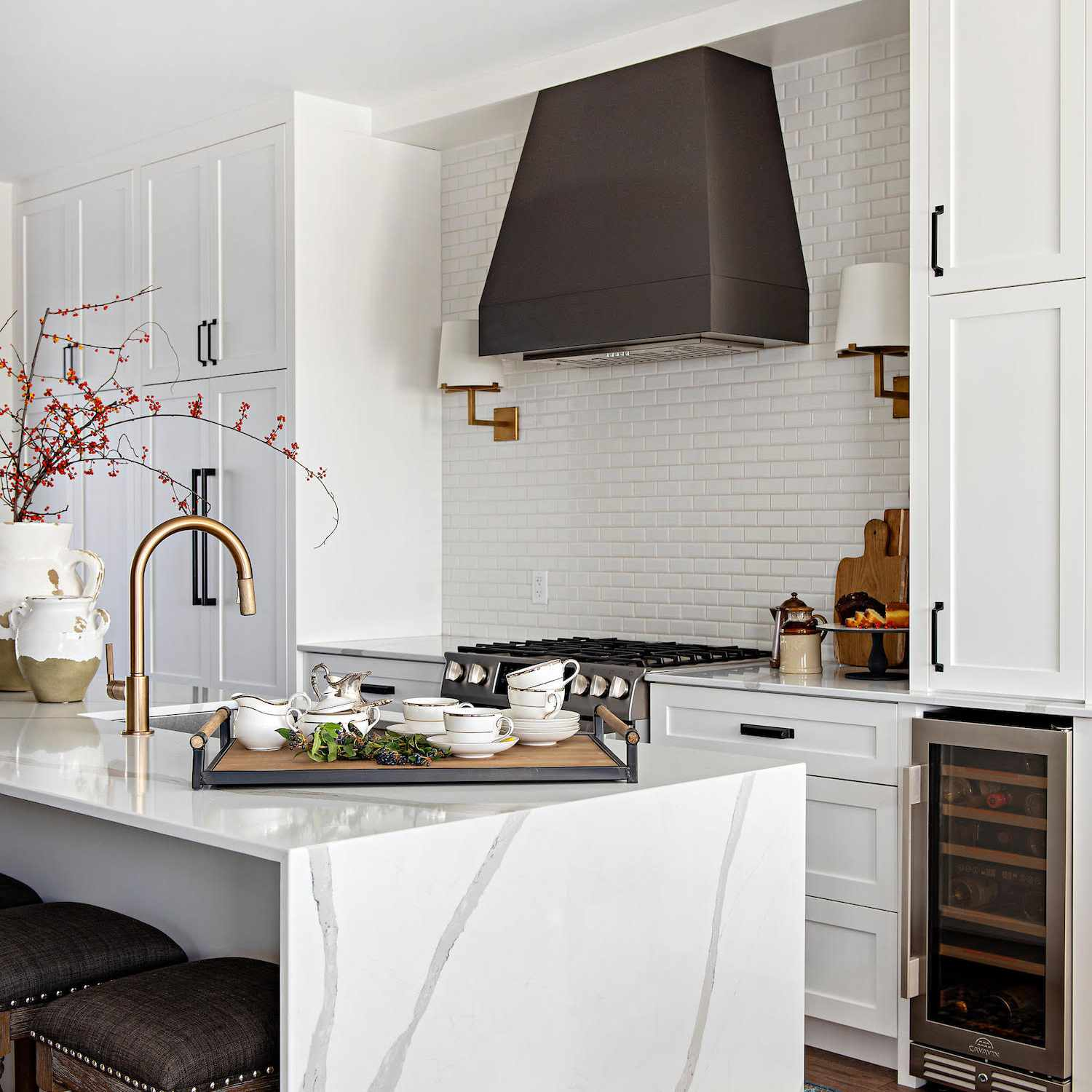 White kitchen with stove hood