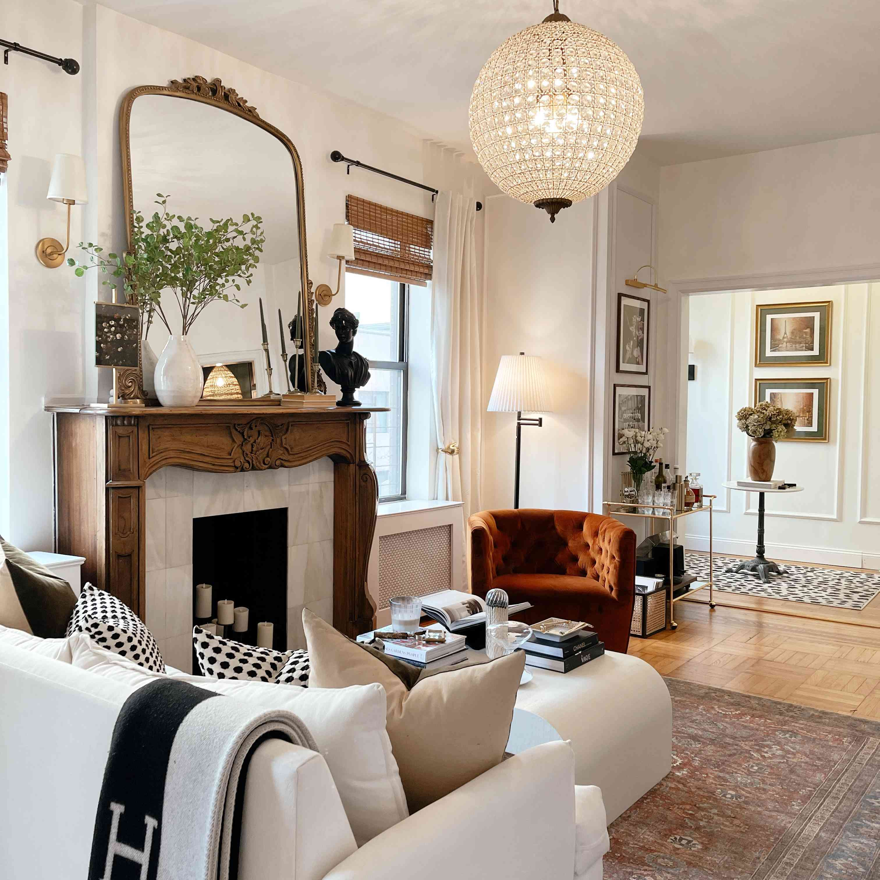 Luxe cozy living room with crystal chandelier.