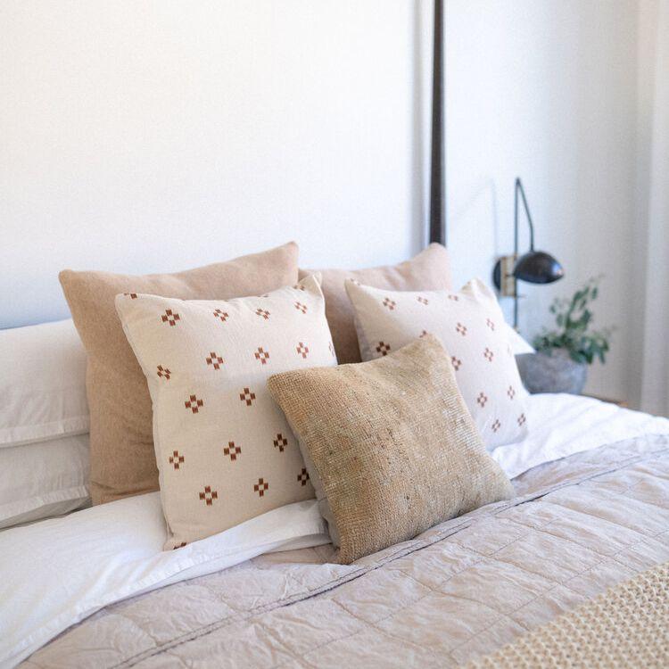 Cozy pink linen bed.