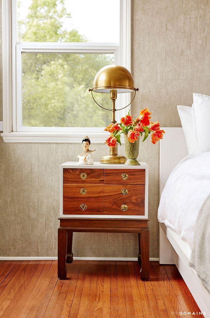 Brass lamp on wood nightstand
