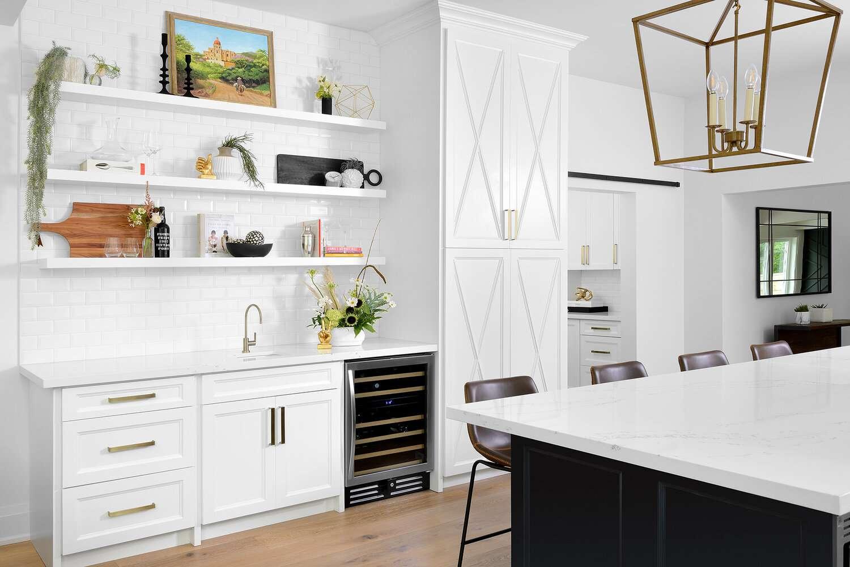 White kitchen with white walls.