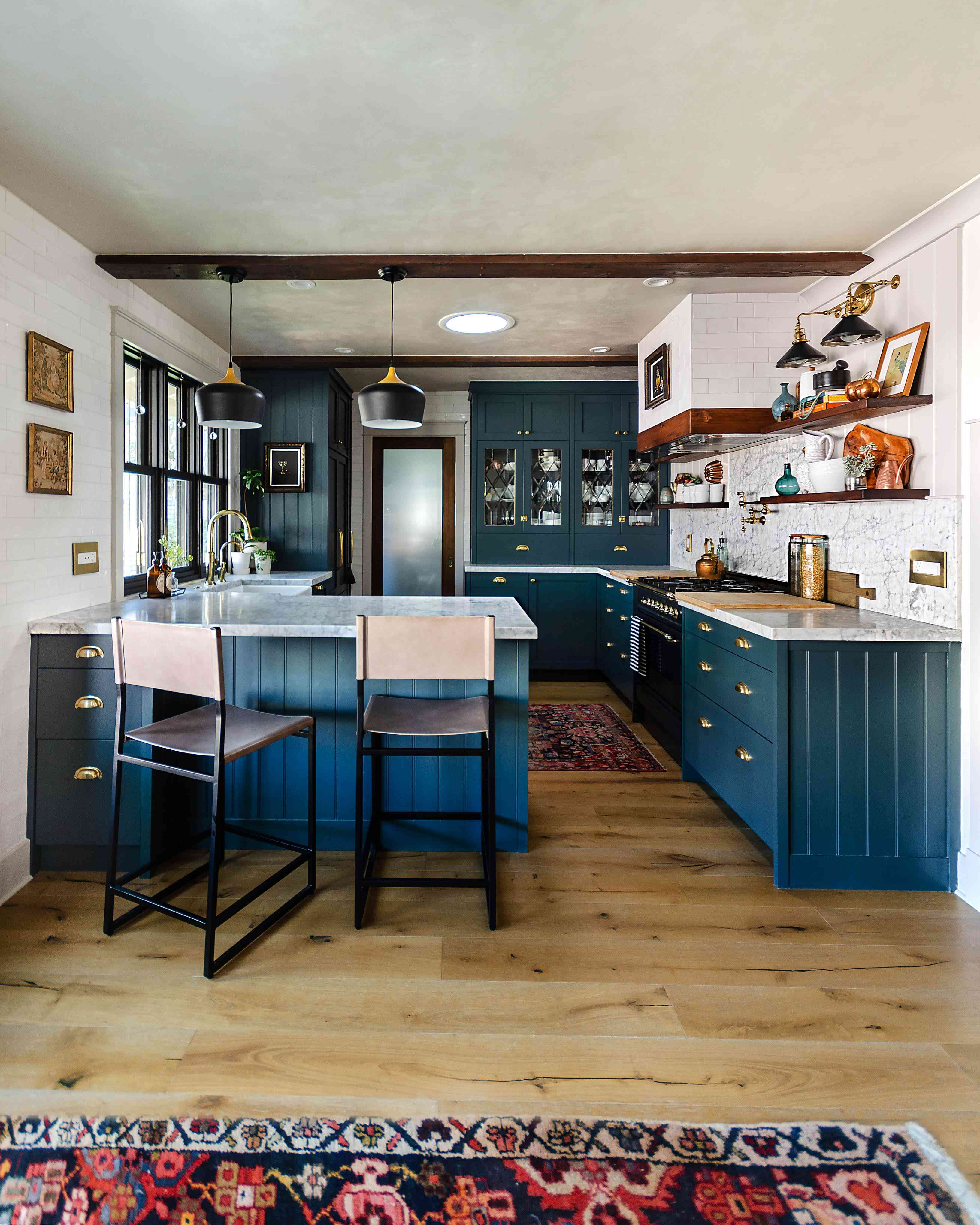 A kitchen lined with blue IKEA cabinets