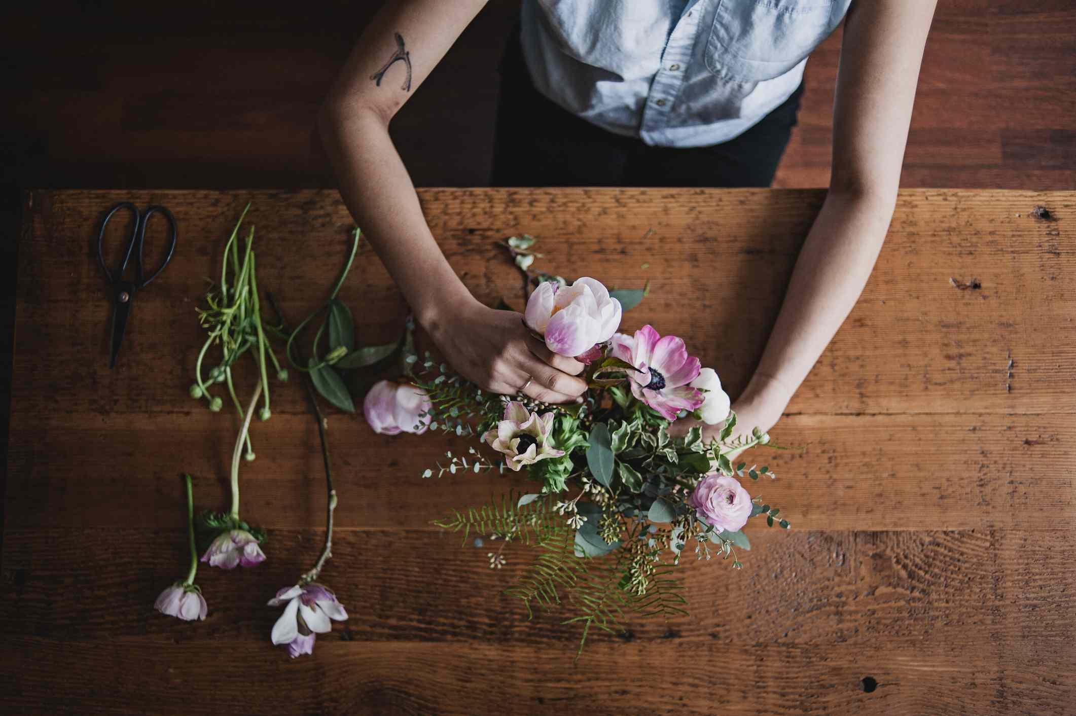 flower bouquet being arranged