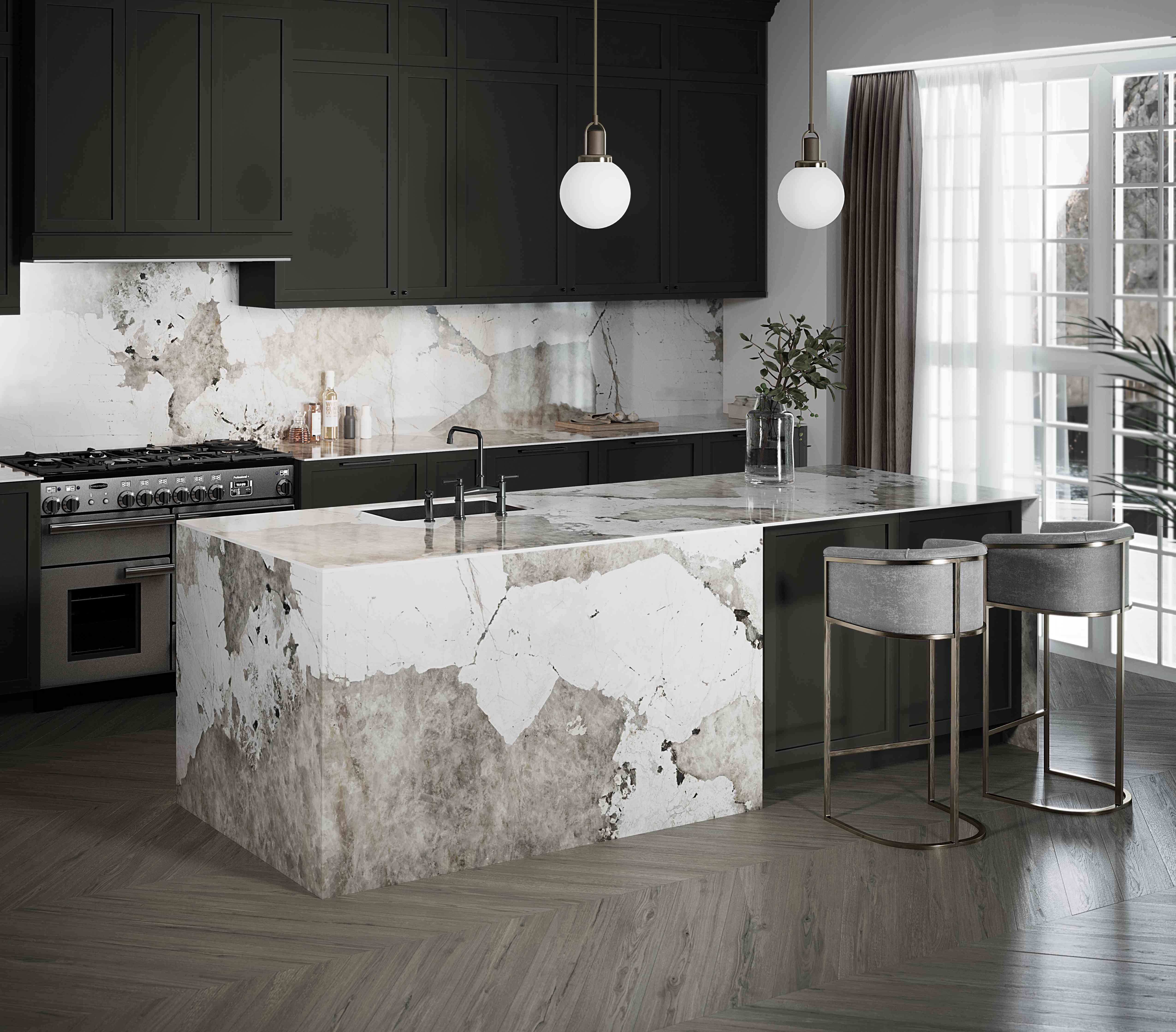 Black cabinets and white marble countertop.