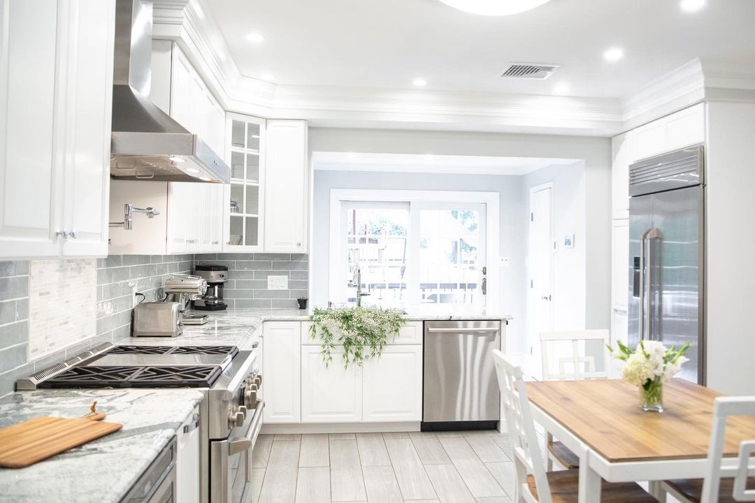 Kitchen with mint green subway tiles