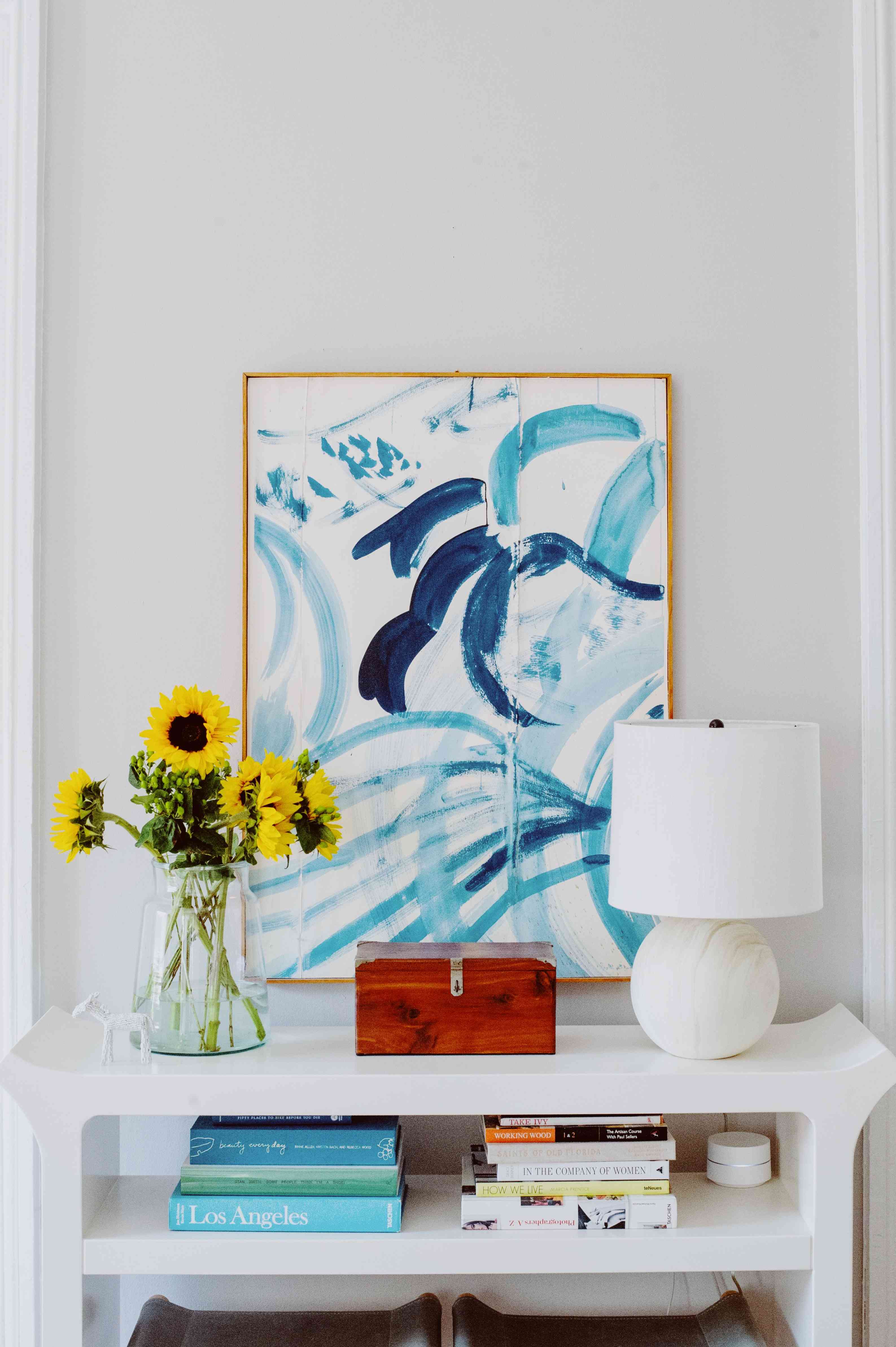 Amanda Greeley home tour - console with books and abstract artwork
