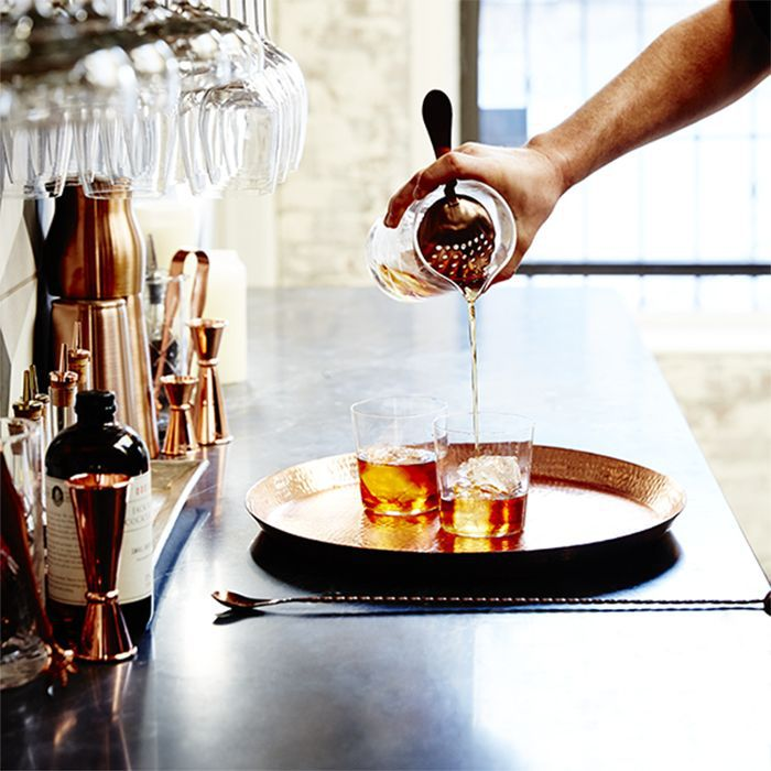 a bartender pouring whiskey