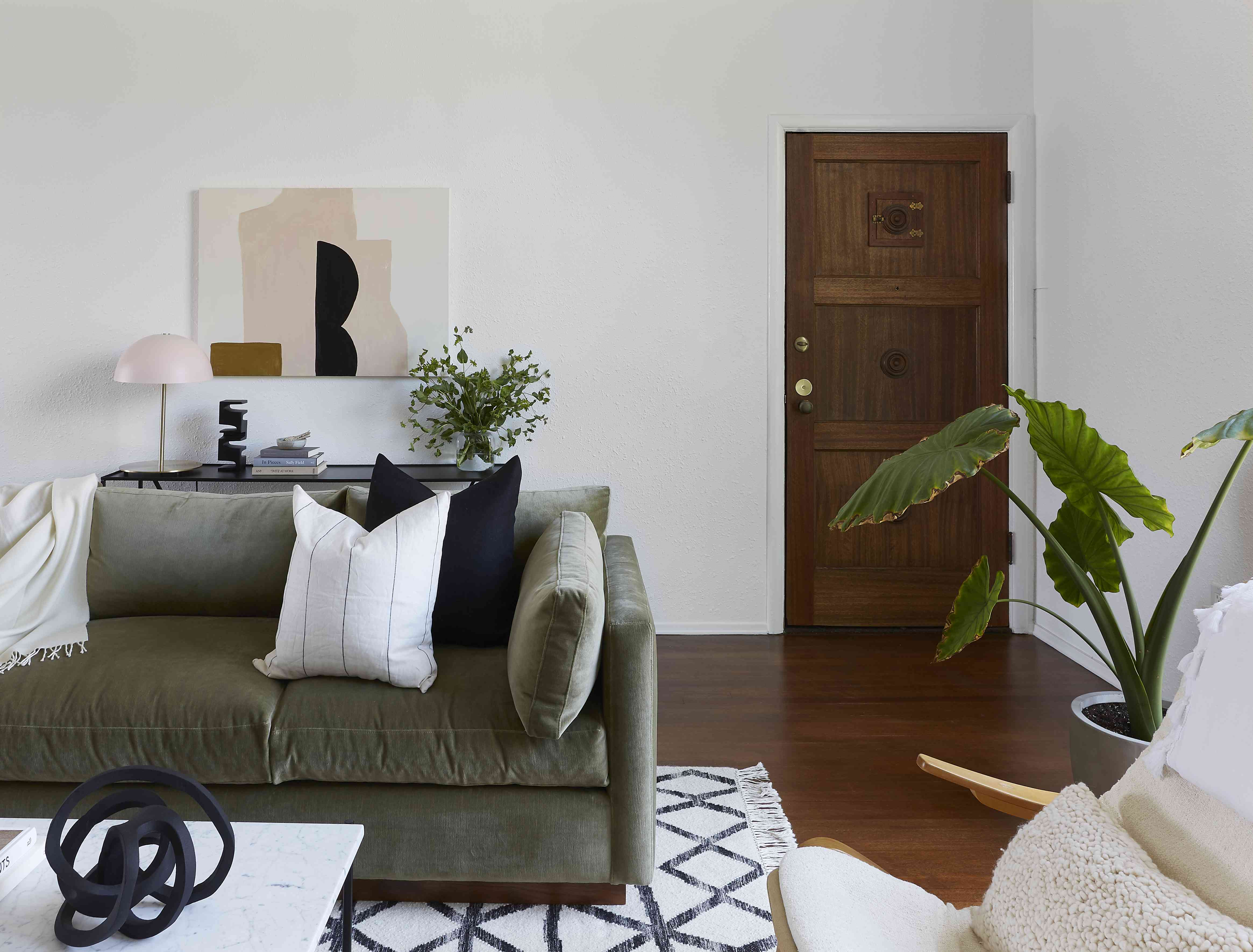 living room with sage green couch