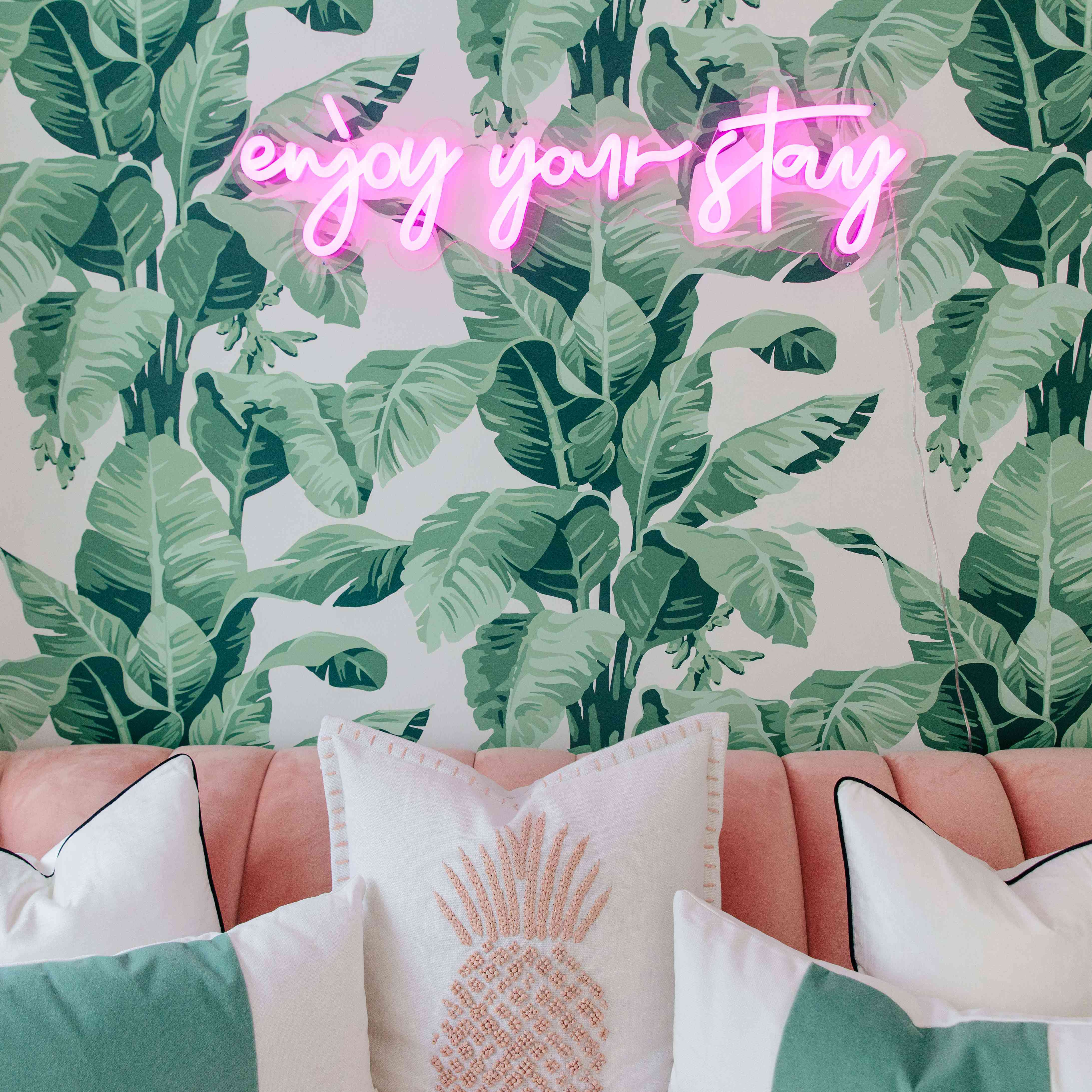 Enjoy your stay neon sign on wall.