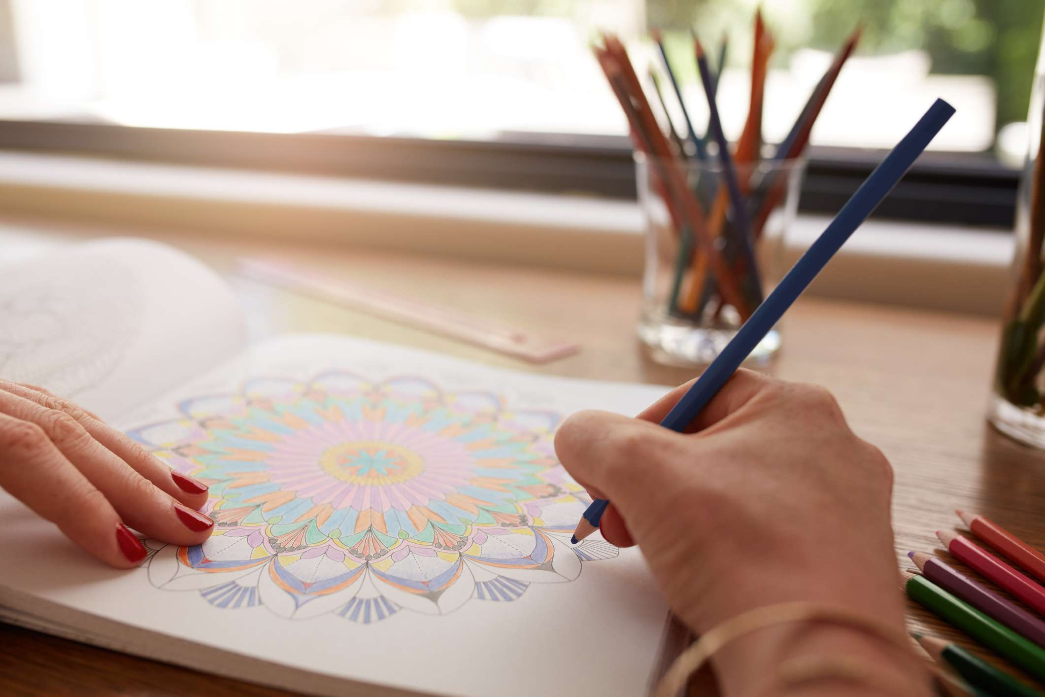 Human hands color in adult coloring book
