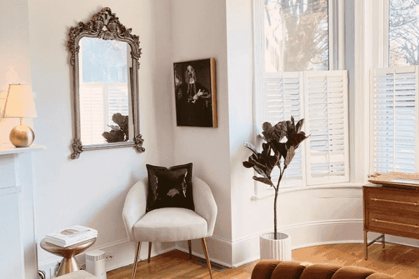 editors' favorite products 2020 - gorgeous townhouse living room with white walls and terracotta velvet couch