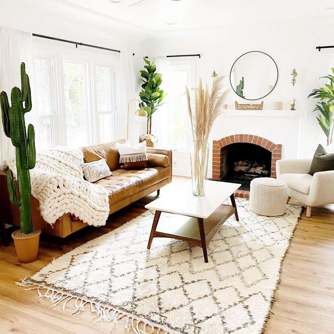 Bright living room with lots of plants.