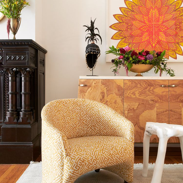 An eclectic vignette of opposing furniture that would never seem like it would go together—it's a great example of risk-taking in design.