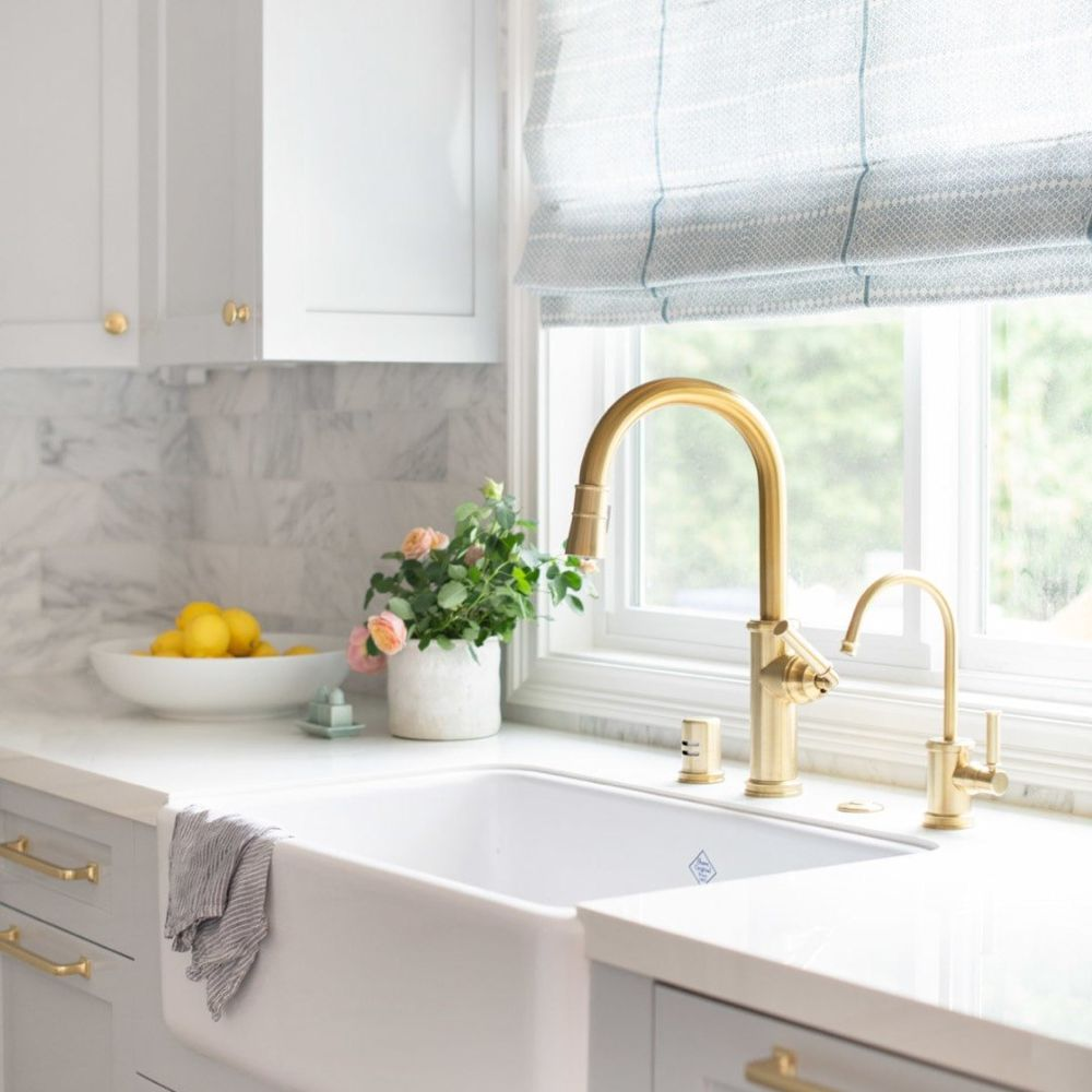 White apron-front skin with brass faucet