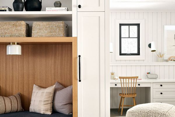 Soft neutral storage space with nook to sit.