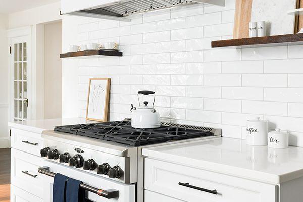 bright white kitchen with tea kettle