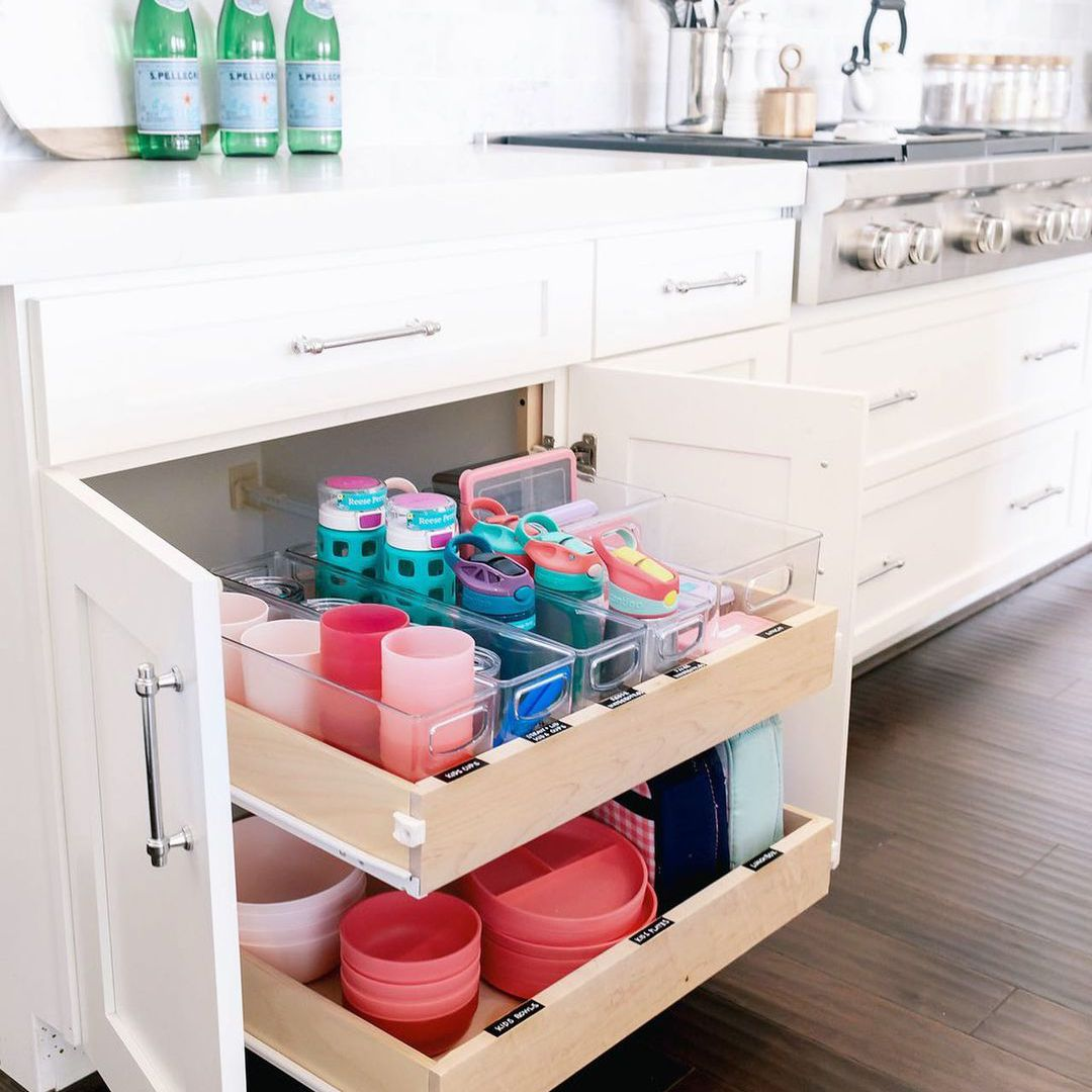 Drawer with kids plates in it