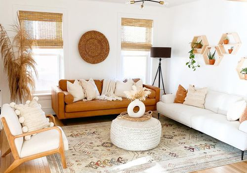 Warm boho living room with burnt orange sofa.