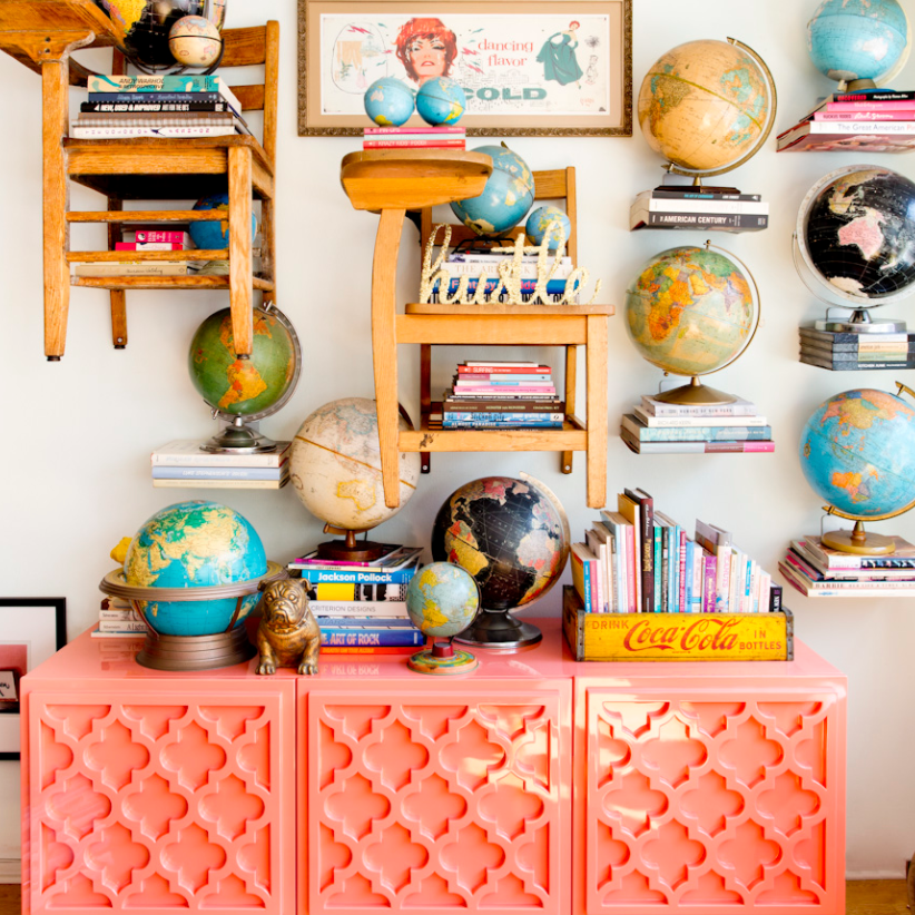 Pink buffet with globes above it