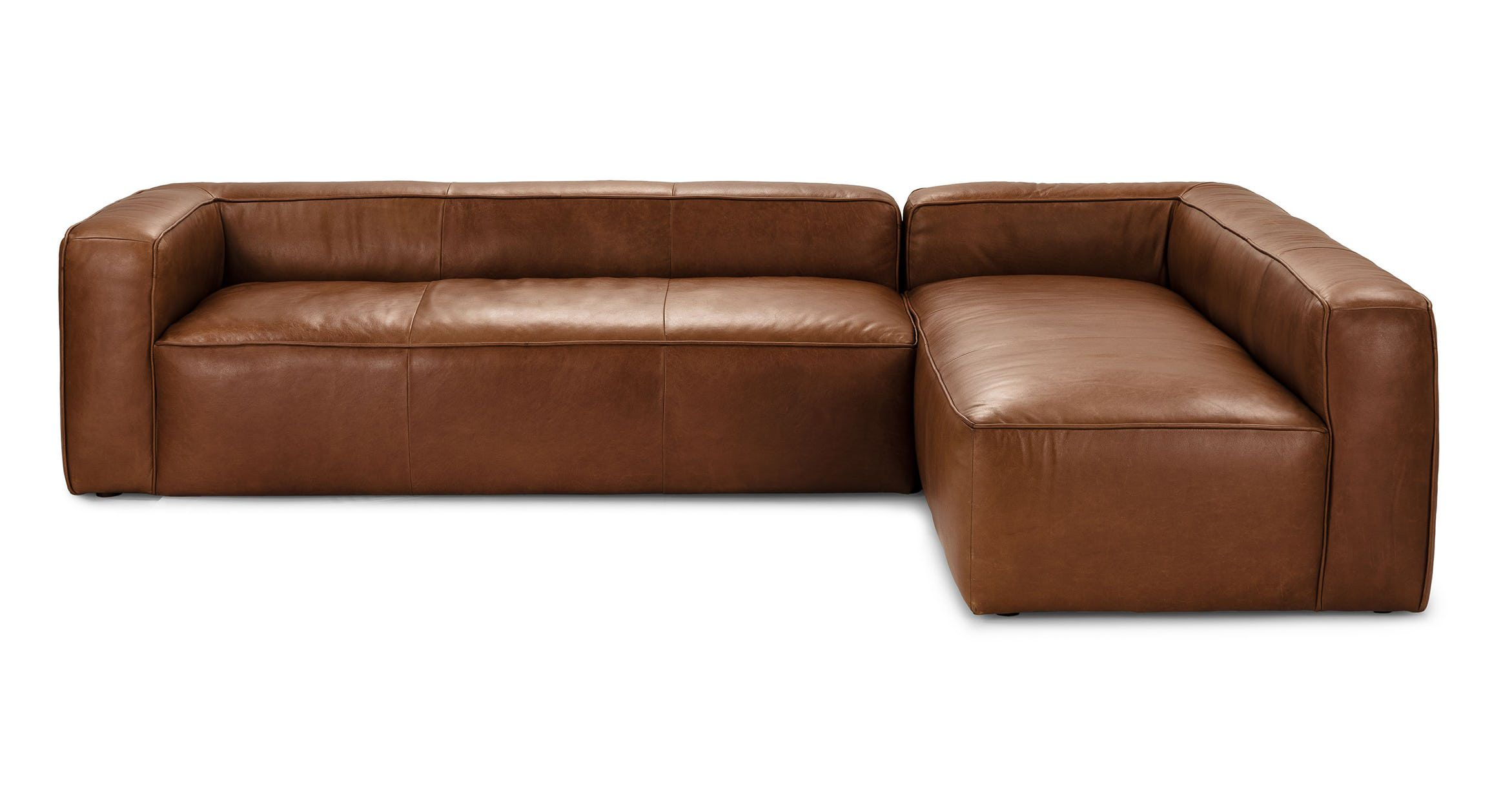 A large modular leather sectional sofa.