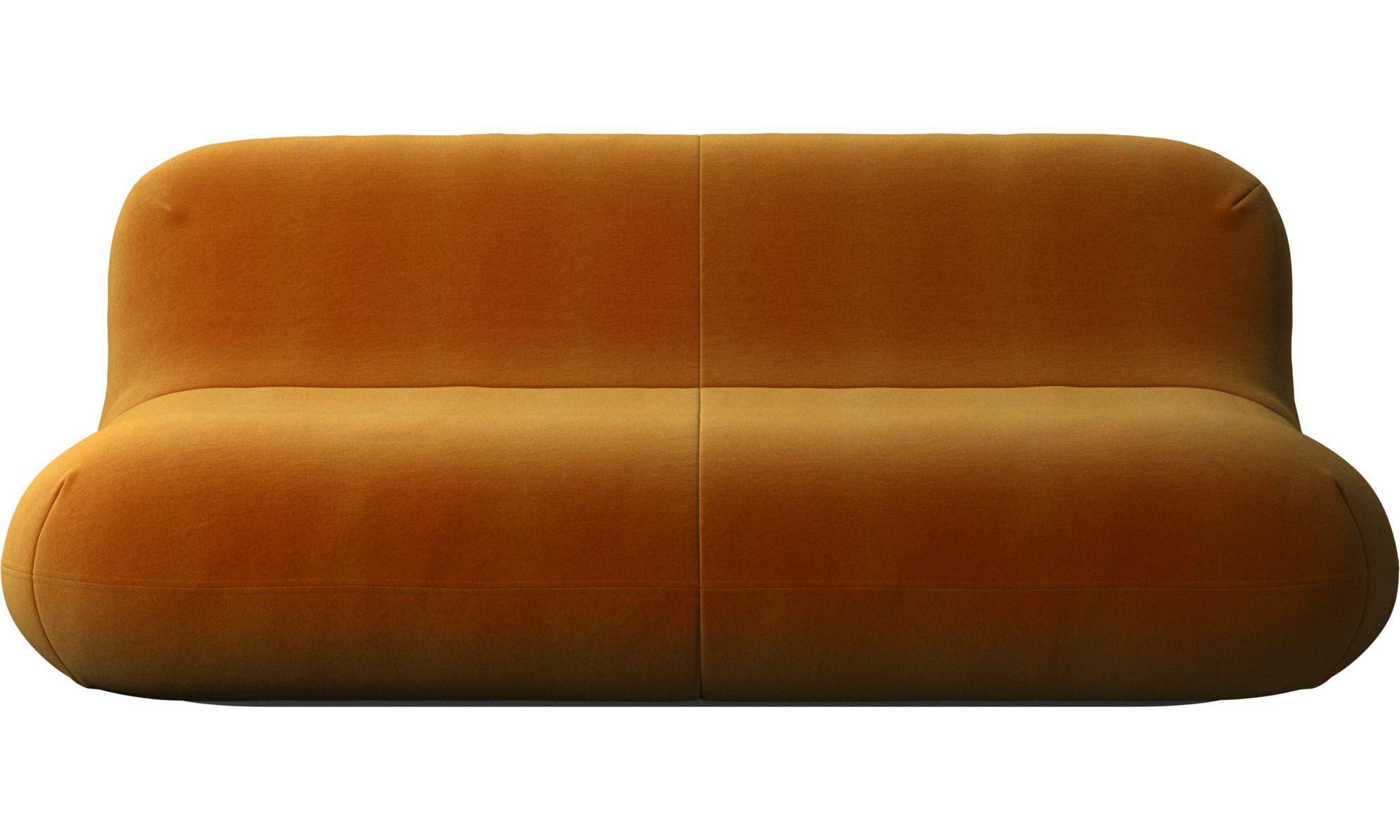 A modern orange-velvet two-seater sofa.