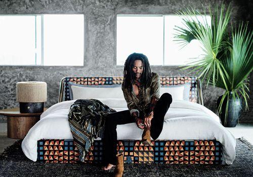 lenny kravitz x cb2 collection - lenny kravitz sitting on a bed