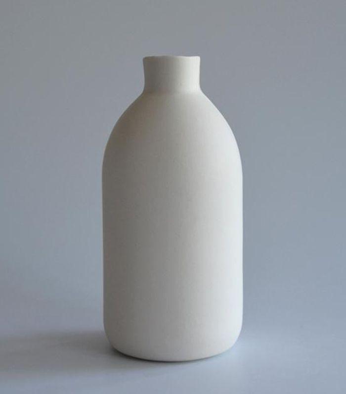 A white, handmade porcelain vase.