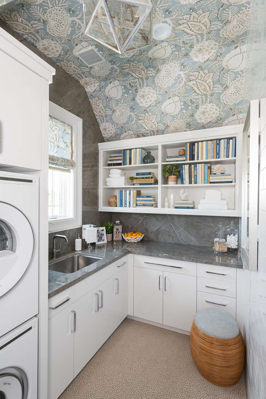 Overview of laundry rook with sink and countertops.