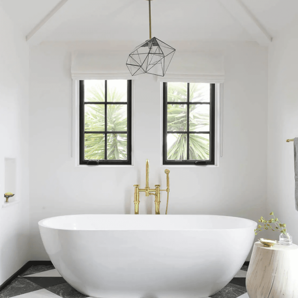 A bathroom with a black, white, and slate gray tiled floor