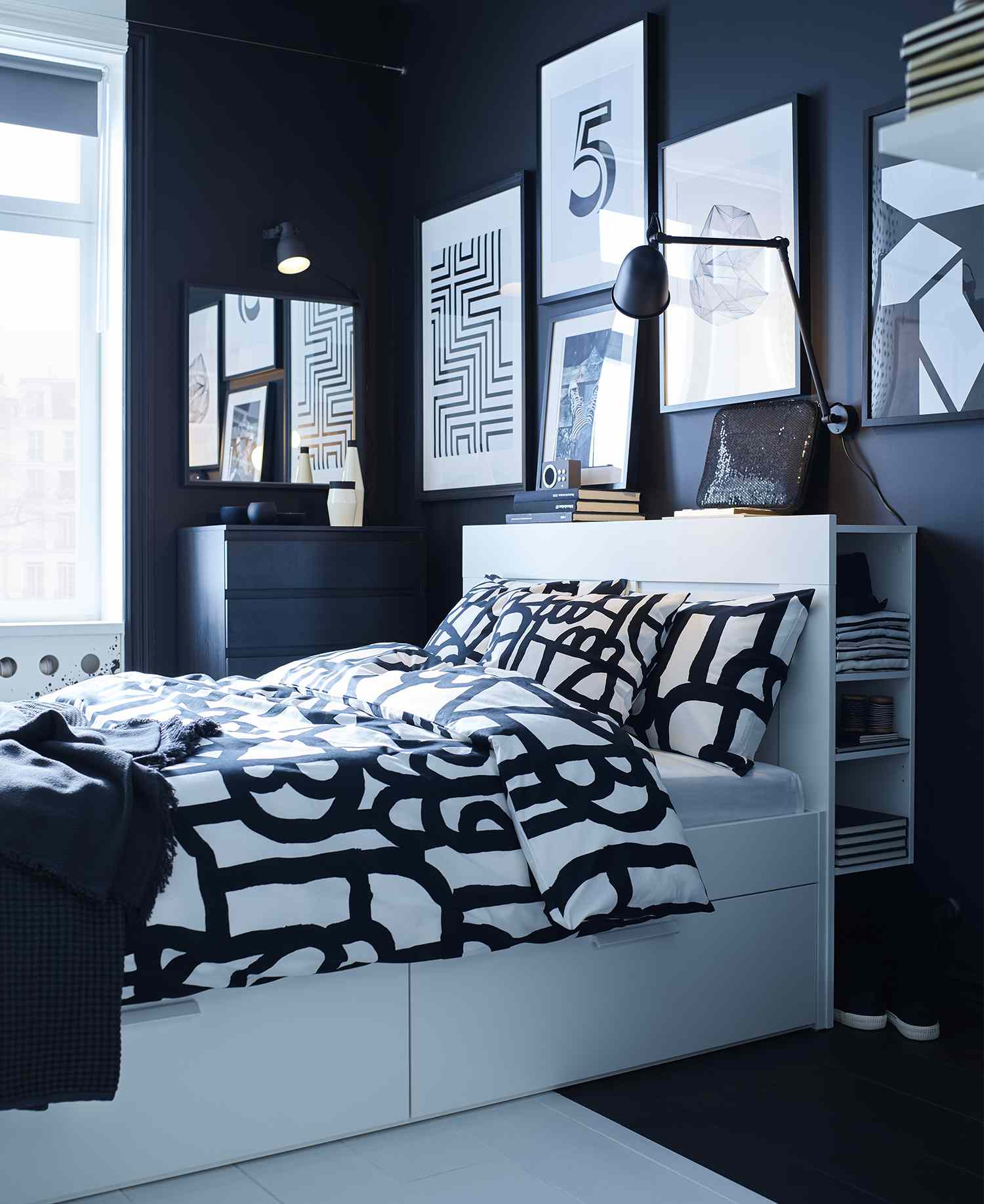 Bedroom with dark walls, a white bed, and black-and-white bedding.