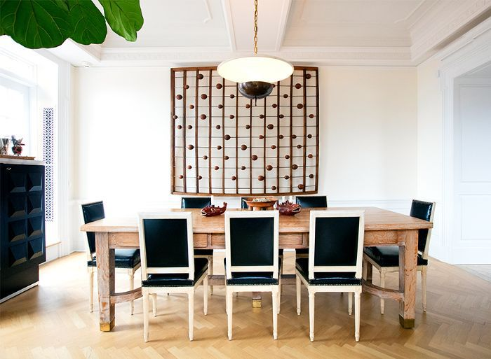 a dining table with eight black chairs
