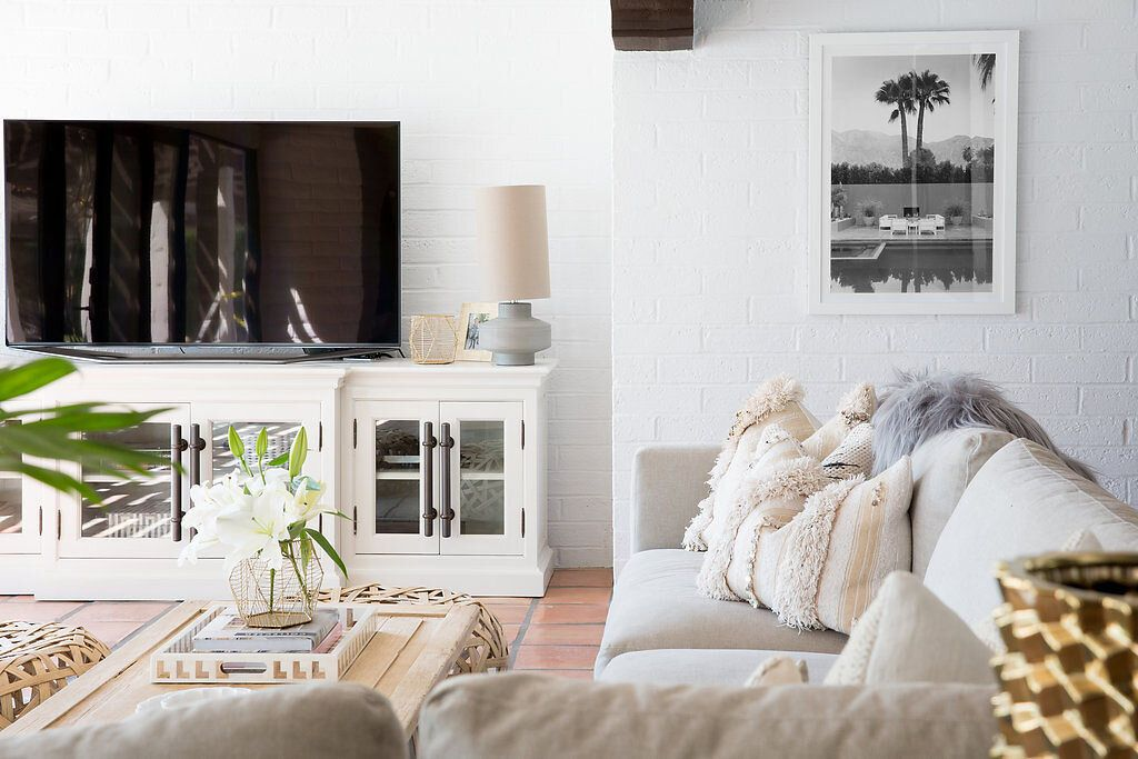 Bright family room with white painted brick wall