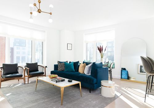 Model unit apartment with luxe velvet couch.