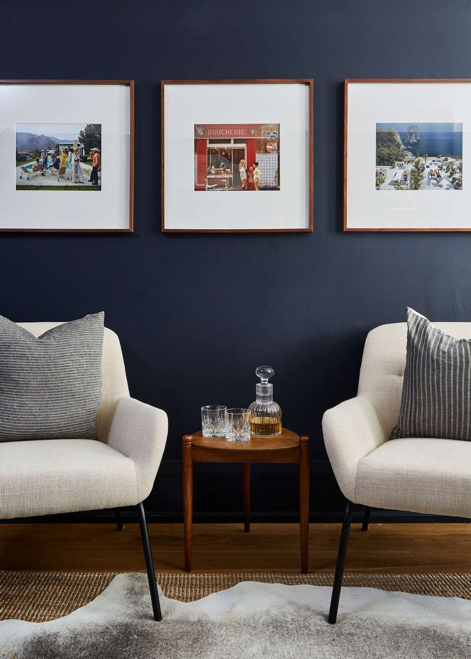 Seating area with photographs on the wall