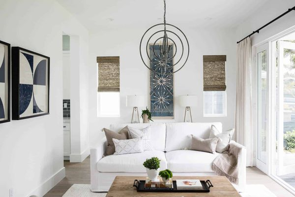 White living room with soft neutral accents.