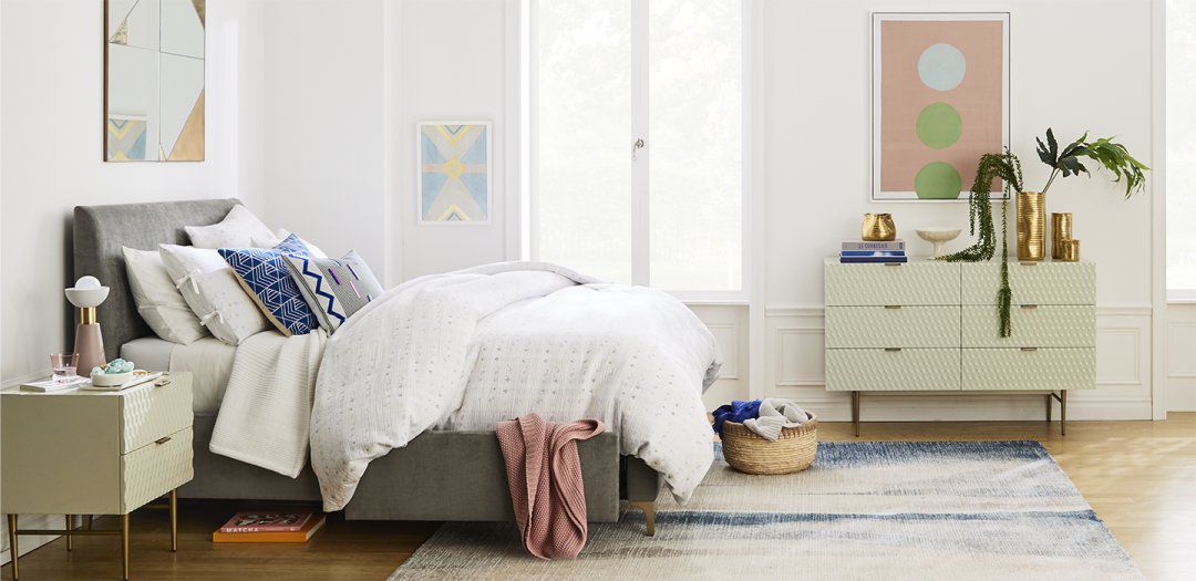 Embellished accents with midcentury furnishings in bedroom.