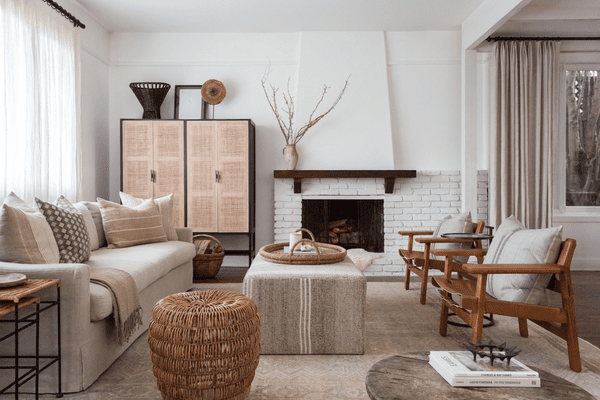 Serene neutral living room with rustic elements.
