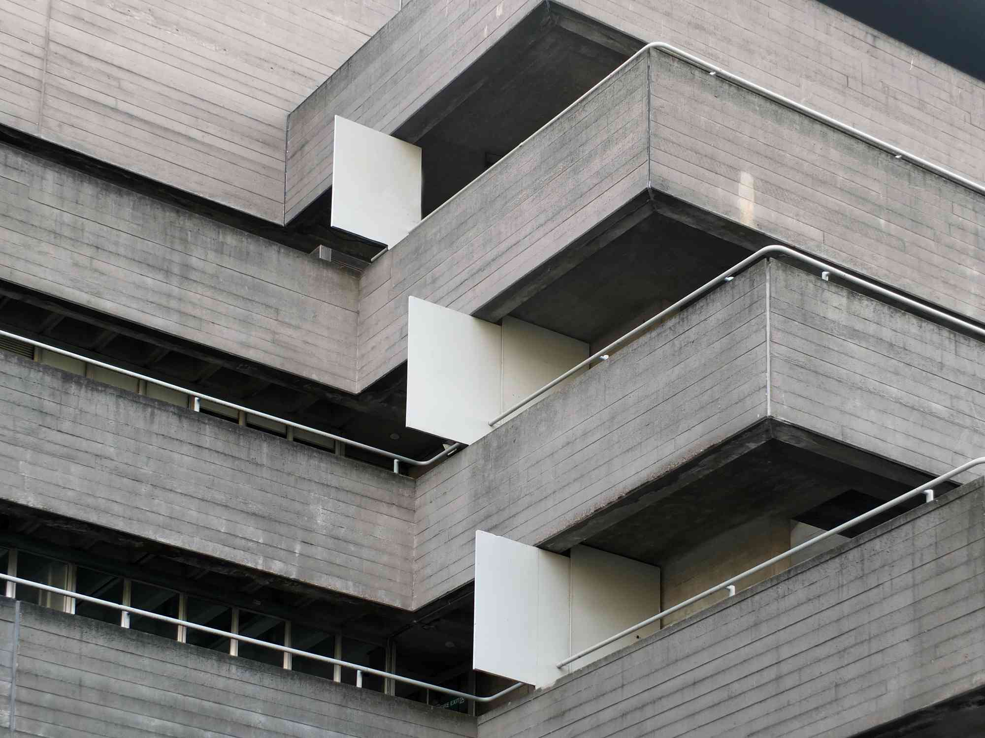 Railings and balconies of old Brutalist building