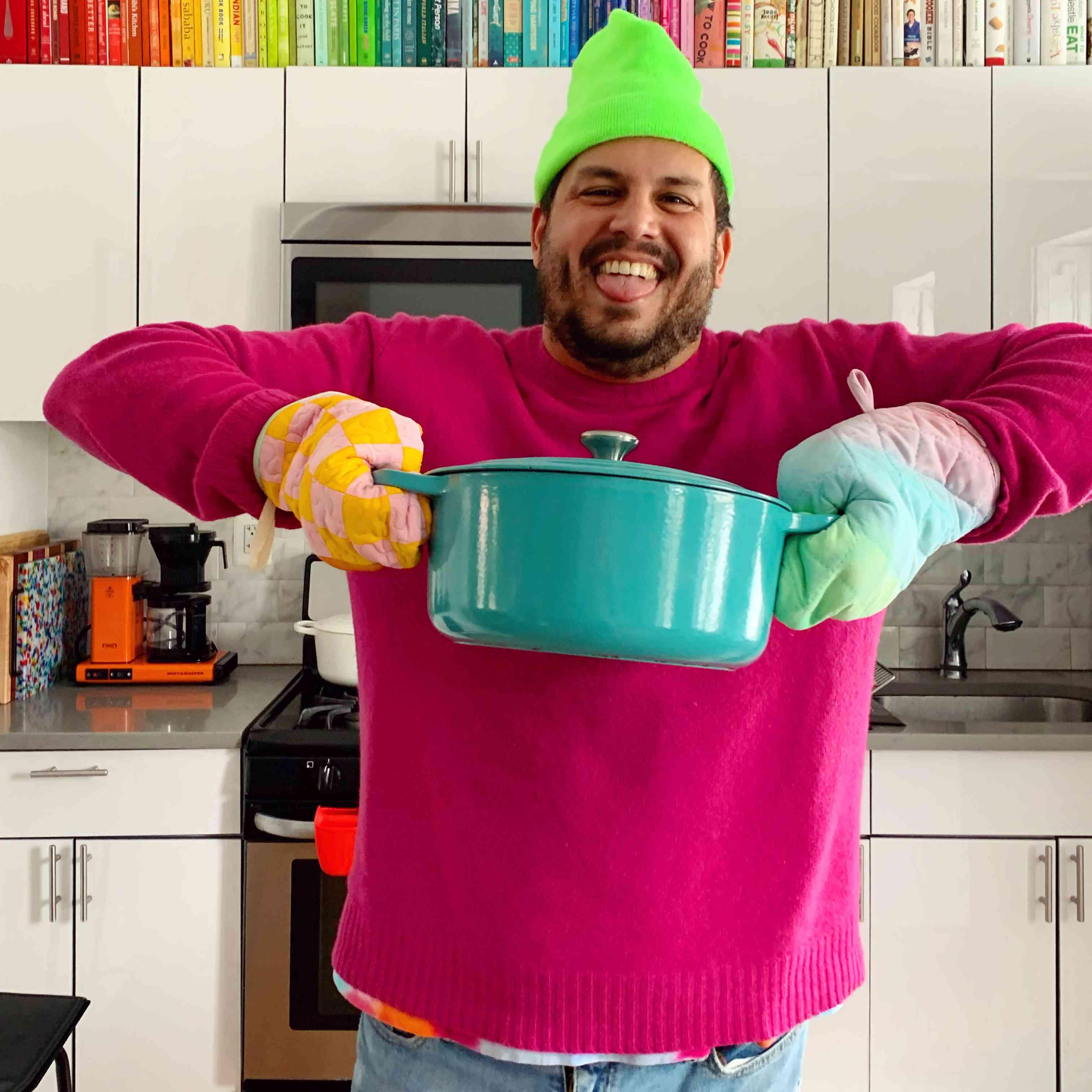 Daniel Pelosi cooking with the unicorn oven mitt.