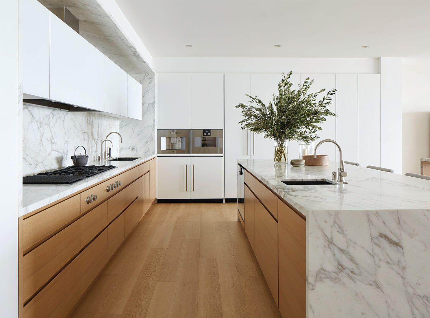 Minimalist kitchen with marble countertops