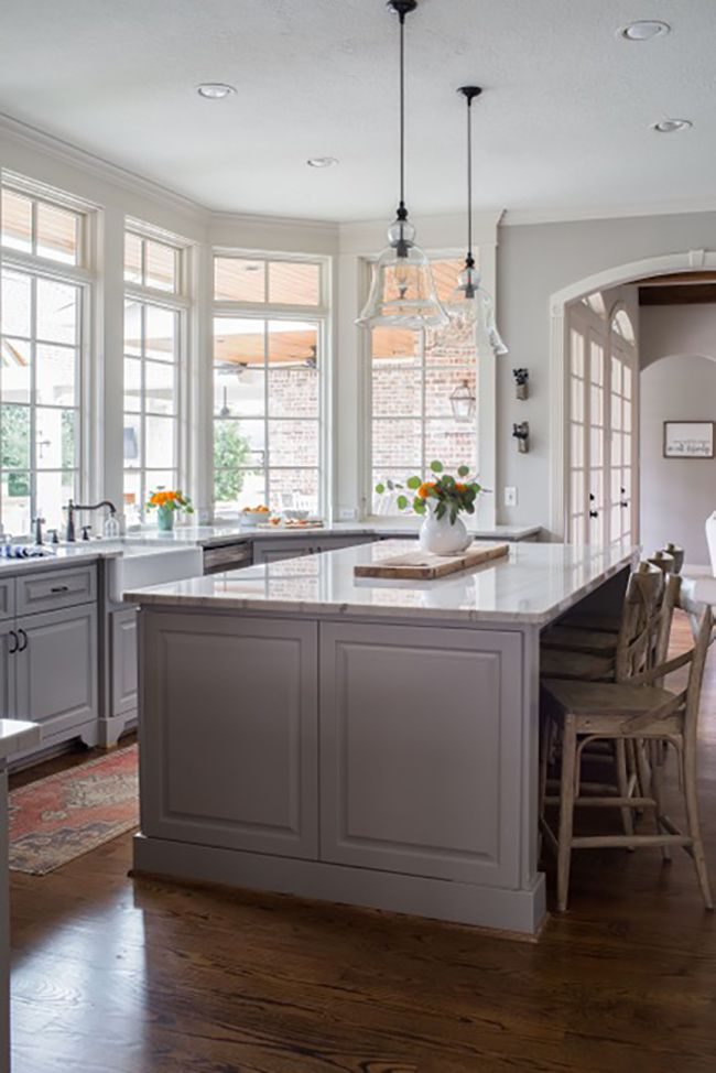 best kitchen ideas - kitchen with gray island and cabinets
