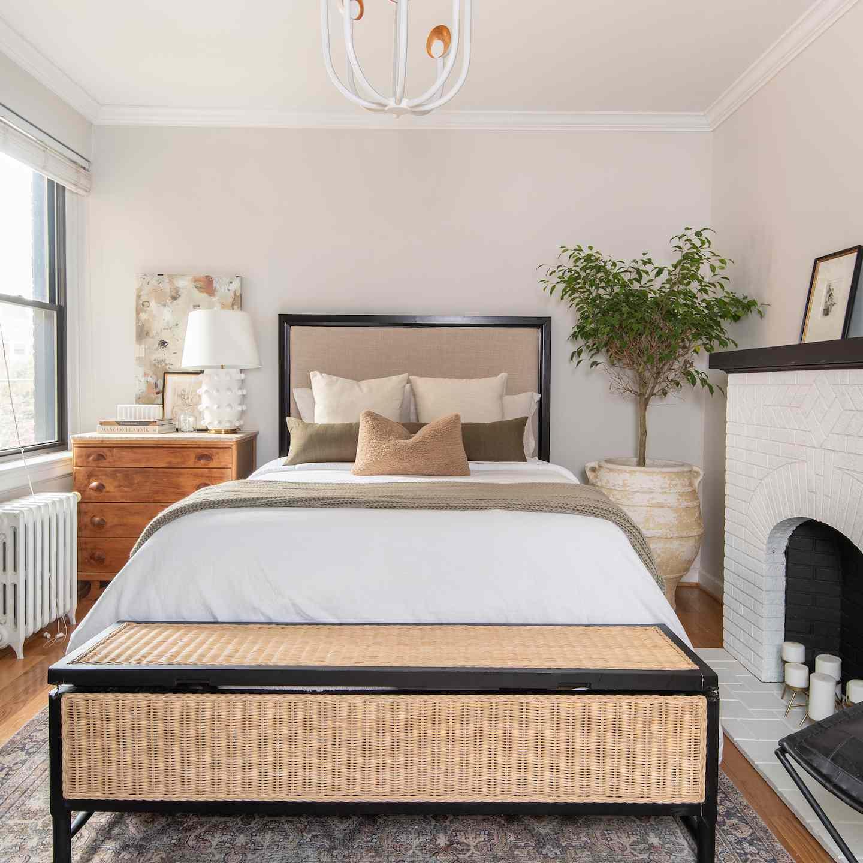 Neutral bedroom with ficus tree in corner.