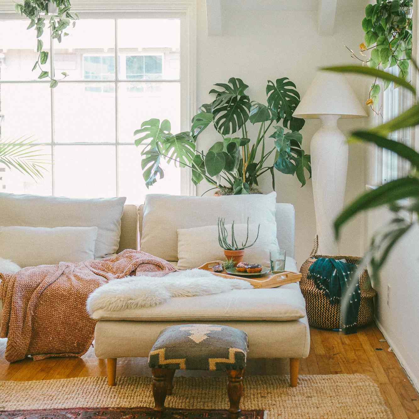 Cozy rental living room with throws, rugs, and pillows