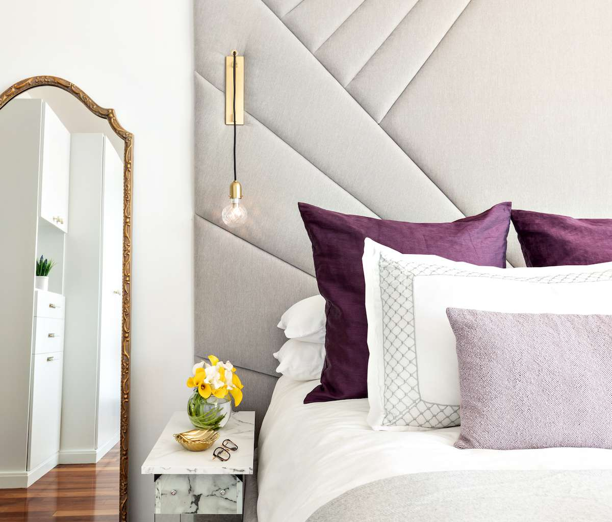 Bed with purple pillows